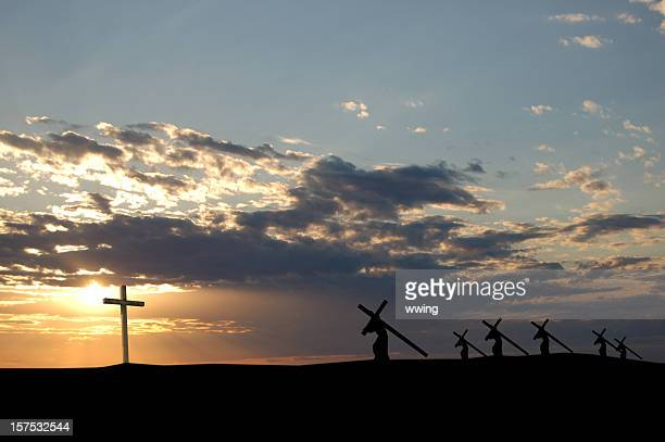 landscape view of the sun and crosses being carried - resurrection religion stock photos and pictures