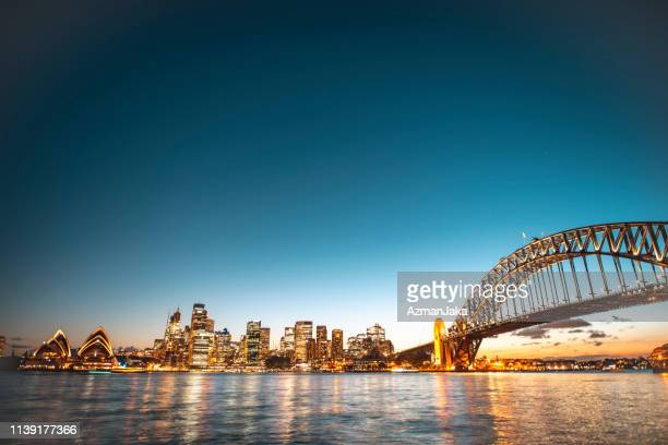 landscape view of the sydney harbor bridge in the evening - skyline stock pictures, royalty-free photos & images