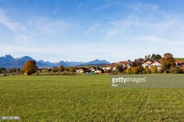 landscape view with a village in the allgäu (allgäu/ bavaria/ germany) - dorf stock-fotos und bilder