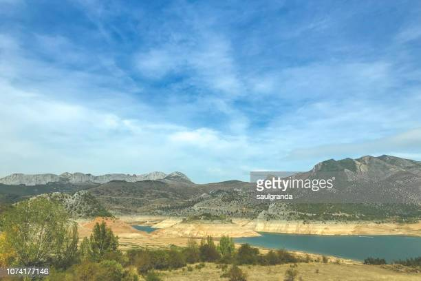 landscape with an almost empty reservoir during a drought - león province spain stock pictures, royalty-free photos & images