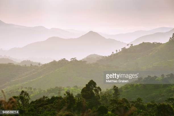 landscape with clouds and sky in the evening haze, fundong, north-west region, cameroon - cameroon stock pictures, royalty-free photos & images