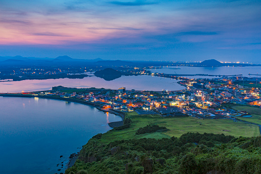Landscape with illuminated town at sunset from high angle view - gettyimageskorea