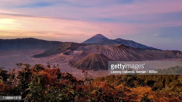 landscape with mount bromo volcano at sunset, east java, indonesia - tengger stock pictures, royalty-free photos & images