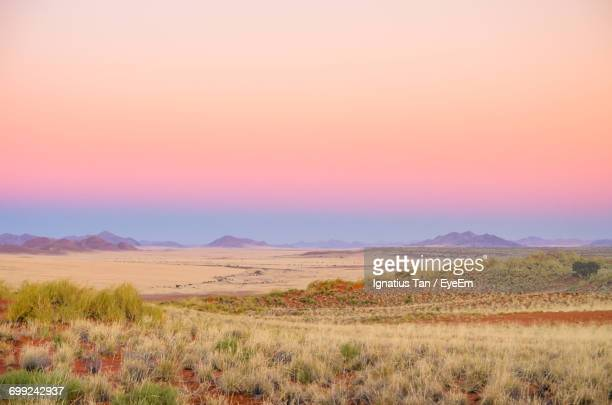 landscape with mountain range in background - ignatius tan stock photos and pictures