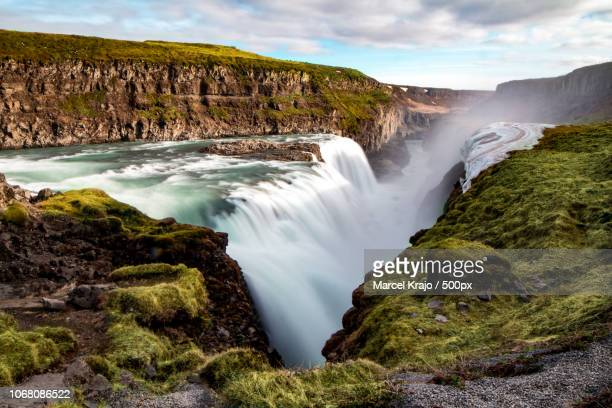 landscape with mountain waterfall - gullfoss falls stock photos and pictures