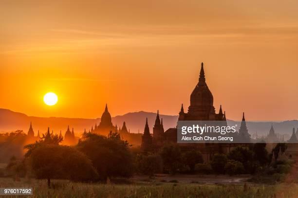 landscape with pagoda silhouette, bagan, myanmar, birma - バガン ストックフォトと画像