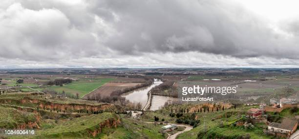 landscape with river and dramatic cloudy sky (rio duero) toro, spain - zamora stock pictures, royalty-free photos & images