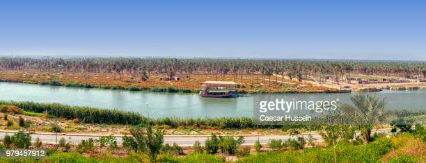 Landscape with river and plains under clear sky, Iraq