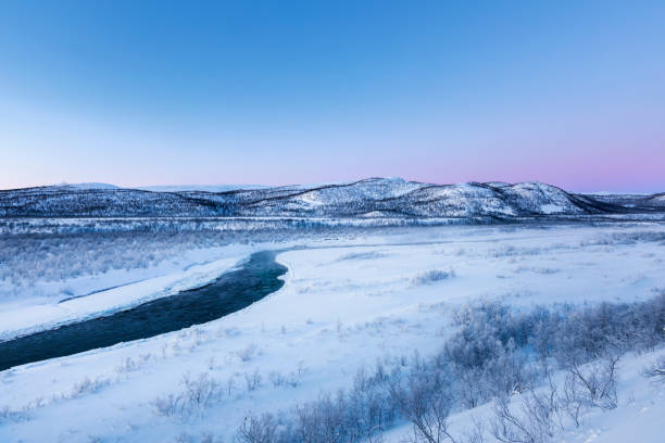 Landscape with river Storelvvassdraget in winter, Lebesby, Norway