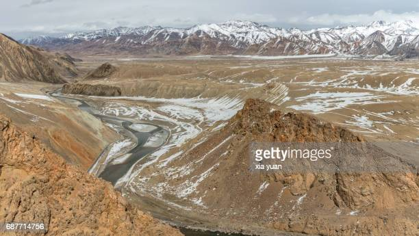 Landscape with river valley and snowcapped mountains in Tashkurgan,China