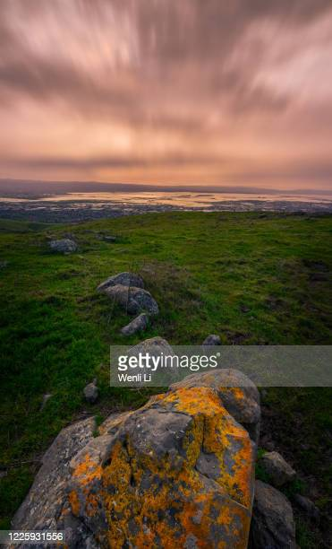 landscape with rock and grass at sunset - fremont california stock pictures, royalty-free photos & images