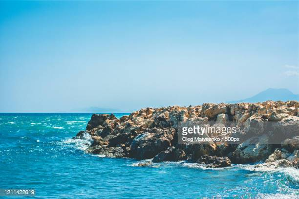 landscape with rocky coastline under clear blue sky, belek, anatolia, turkey - belek stock pictures, royalty-free photos & images