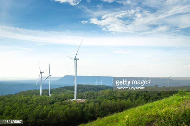 landscape with turbine green energy electricity, windmill for electric power production, wind turbines generating electricity on the mountain , clean energy concept. - mill stock pictures, royalty-free photos & images