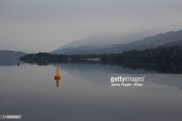 landscape with view of lake - james popple stock photos and pictures