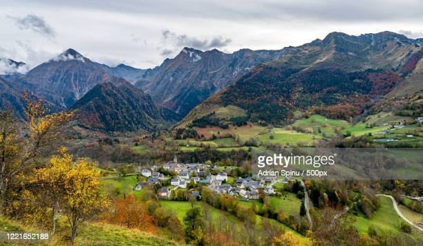 landscape with village surrounded by pyrenees, azet, hautes-pyrenees, france - hautes pyrenees stock pictures, royalty-free photos & images