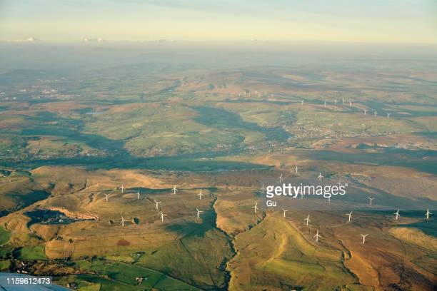 landscape with wind turbines, lancashire, uk - lancashire stock pictures, royalty-free photos & images