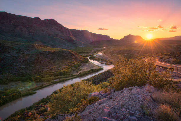 landscape with winding river at sunset - horizontal stock pictures, royalty-free photos & images