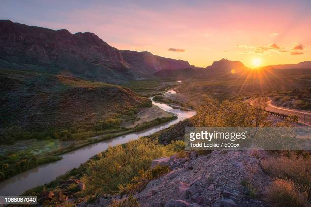 landscape with winding river at sunset - horizontal fotografías e imágenes de stock