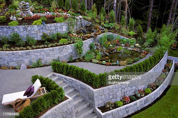 landscaped garden retaining wall - landscaped stock pictures, royalty-free photos & images