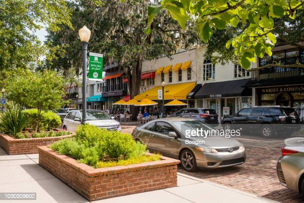 landscaped plants line park avenue sidewalk in downtown winter park florida usa - florida landscaping stock pictures, royalty-free photos & images