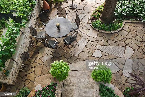 Landscaped Stone Patio Back Yard with Garden and Flower Beds