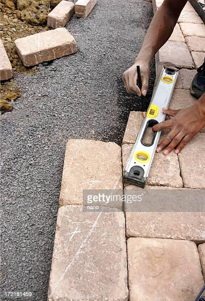 landscaper measuring walkway
