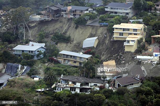 A landslide in the Bluebird canyon area of Laguna Beach saturated by unusually heavy winter rains gave way destroying seven homes and damaging 11...
