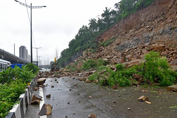 IND: Heavy Overnight Rain In Mumbai Causes Landslide On Western Express Highway, Affects Traffic