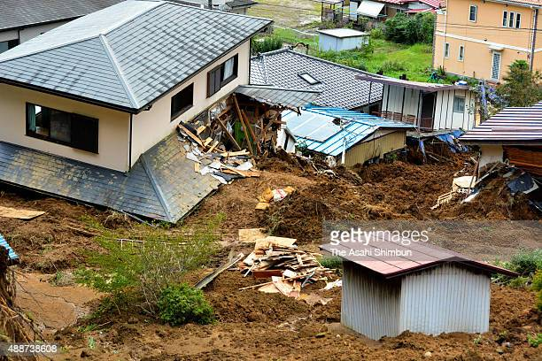 A landslide site where a woman found dead after the torrential rain is seen on September 11 2015 in Kanuma Tochigi Japan
