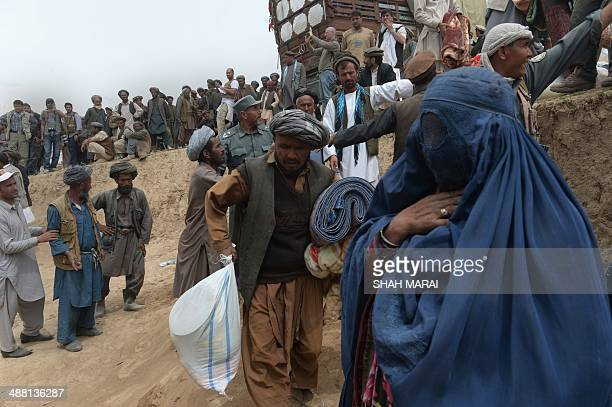 Landslideaffected Afghan villagers receive relief supplies during aid distribution at the scene of the disaster in Argo district of Badakhshan on May...