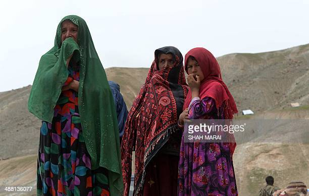 Landslide-affected Afghan villagers weep at the scene of the disaster in Argo district of Badakhshan on May 4, 2014. Aid groups rushed to reach...
