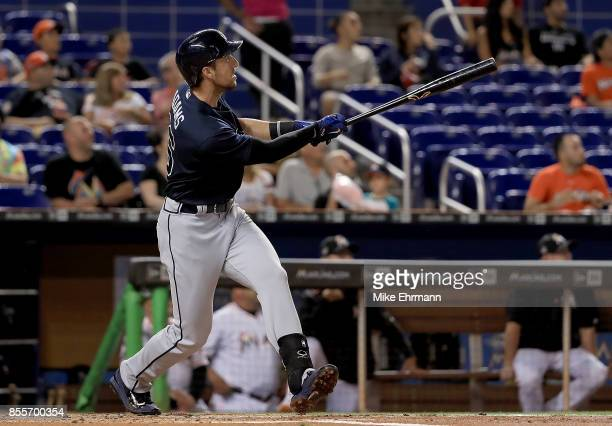 Lane Adams of the Atlanta Braves hits a three run home run in the first inning during a game against the Miami Marlins at Marlins Park on September...
