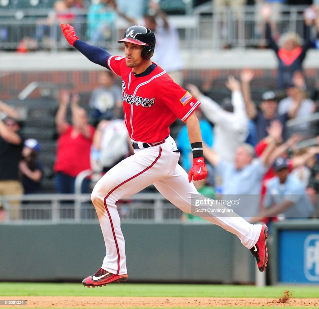 Lane Adams #16 of the Atlanta Braves rounds the bases after hitting a 10th inning two-run walkoff home run against the Miami Marlins at SunTrust Park on September 10, 2017 in Atlanta, Georgia.