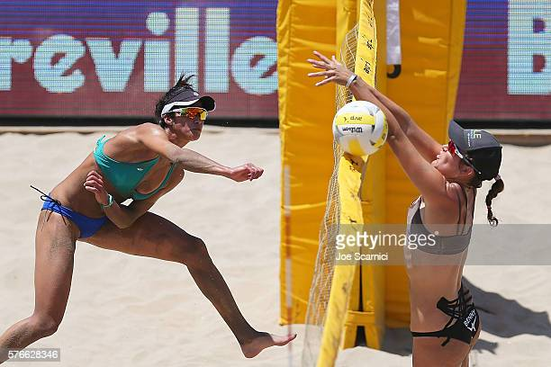 Lane Carico spikes the ball past Angela Bensend during their quarter final match at AVP Beach Volleyball Manhattan Beach on July 16 2016 in Manhattan...