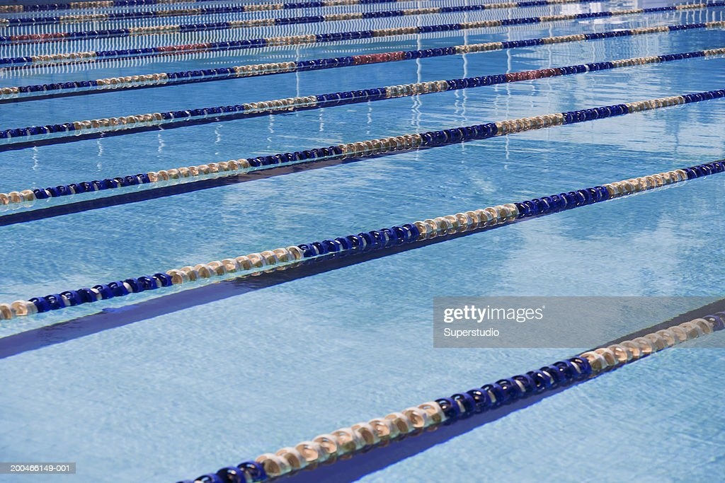 lane dividers in olympic size swimming pool stock photo