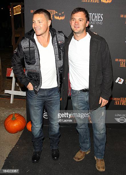 Lane Garrison and Austin Hebert attend the 5th Annual Los Angeles Haunted Hayride Premiere Night at Griffith Park on October 10 2013 in Los Angeles...