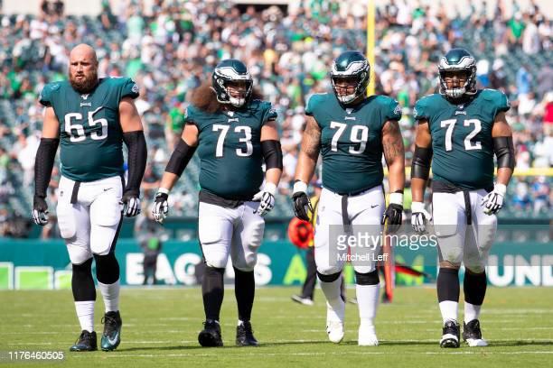 Lane Johnson Isaac Seumalo Brandon Brooks and Halapoulivaati Vaitai of the Philadelphia Eagles walk to the locker room during halftime against the...