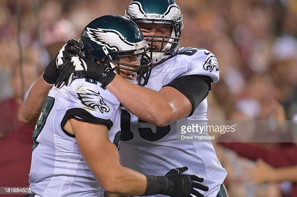 Lane Johnson of the Philadelphia Eagles and Brent Celek celebrate a touchdown against the Washington Redskins at FedEx Field on September 9 2013 in...