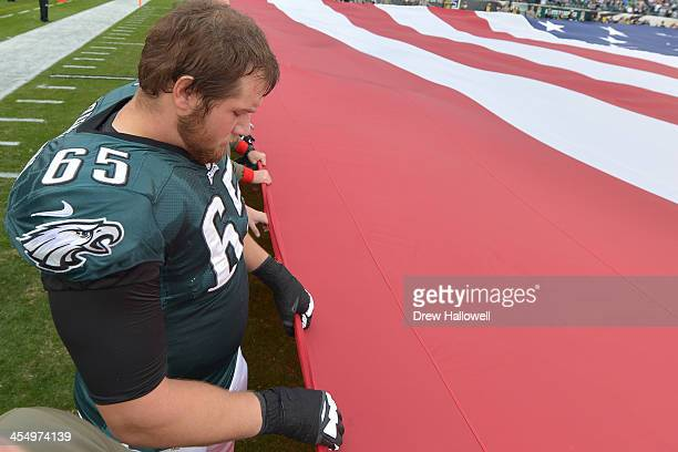 Lane Johnson of the Philadelphia Eagles observes the national anthem before the game against the Washington Redskins at Lincoln Financial Field on...
