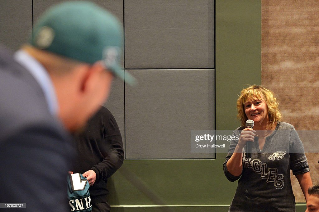 Lane Johnson (L) of the Philadelphia Eagles takes a question from a fan at the NovaCare Complex on April 26, 2013 in Philadelphia, Pennsylvania.
