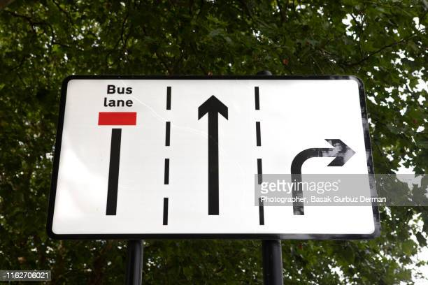 lane signs, road sign - basak gurbuz derman stock photos and pictures