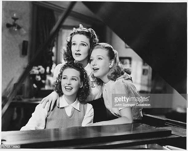 Lane Sisters Singing at a Piano