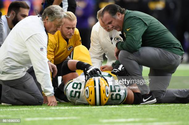 Lane Taylor of the Green Bay Packers lays on the field after being injured during the second quarter of the game against the Minnesota Vikings on...
