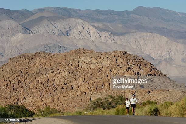 Lane Vogel of Jacksonville Florida ascends Whitney Portal Road through the Alabama Hills toward the finish of the AdventurCORPS Badwater 135...