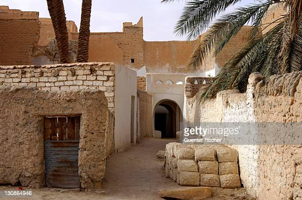 Lane with a pile of mud bricks in the backyards of the oasis of Ghadames, UNESCO world heritage, Libya