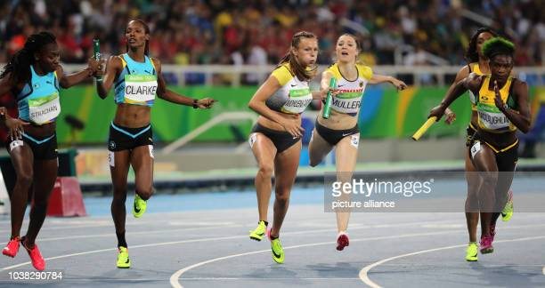 Lanece Clarke and of Bahamas Laura Mueller and Friederike Mohlenkamp of Germany and Anneisha McLaughlinWhilby of Jamaica compete in Women's 4 x 400m...