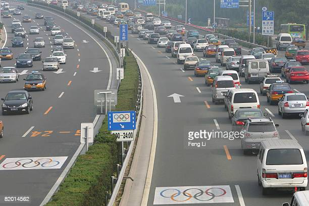 Lanes next to the central fence, which are reserved as Olympic lanes which require special permits, sit empty during morning rush hour on the 4 Ring...