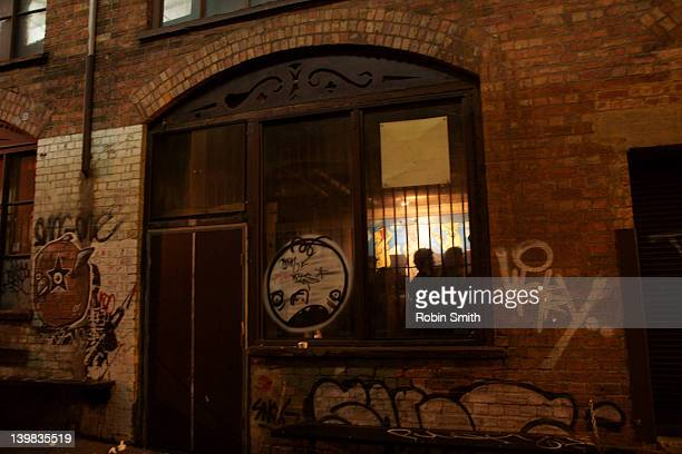Laneway and illuminated window at night, Melbourne, Victoria, Australia