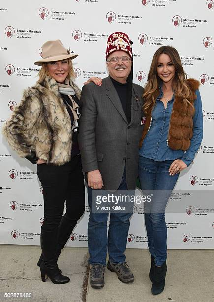 Laney Ziv Shriners Hospitals forChildren Los Angeles board chairman David R Doan and Courtney Sixx attend Celebrities Decorate The Shriners Rose...