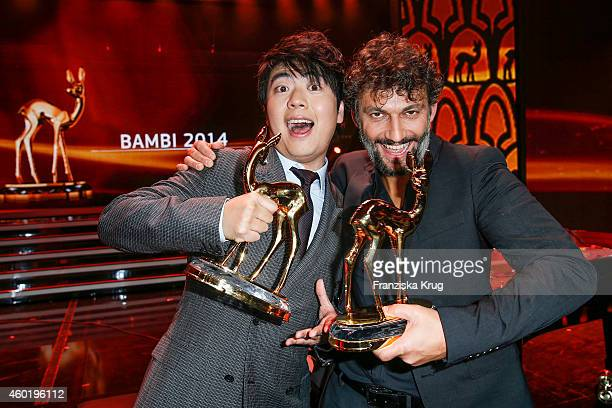 Lang Lang and Jonas Kaufmann pose with their awards after the Bambi Awards 2014 show on November 14 2014 in Berlin Germany